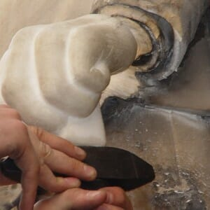 Fixing new Carrara Marble hand carved by Tom Nicholls